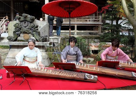 Japanese women playing the traditional instrument