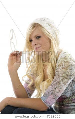 Girl Sitting With Glasses In Mouth Close