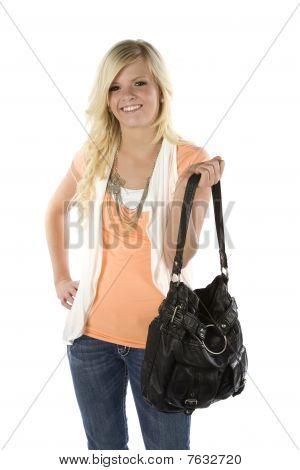 Girl With Orange Shirt Holding Purse