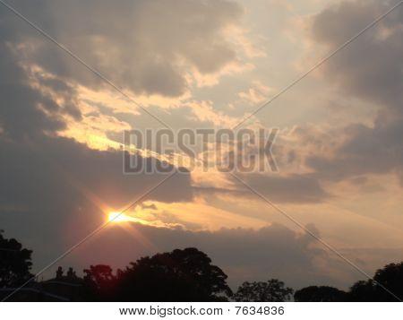 Sun Showing through Dark Clouds