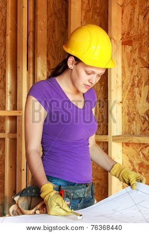 Young woman construction worker