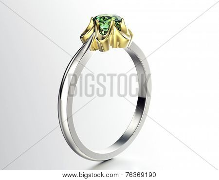 Golden Ring with Diamond. Jewelry background. Peridot or emerald