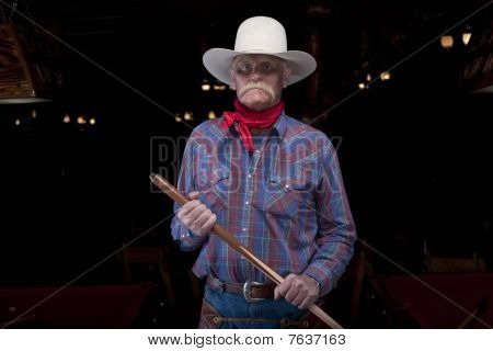 Senior Cowboy Holding Pool Cue