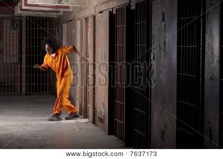 Young Man Sneaking Out Of Prison