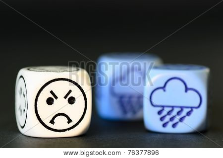 Concept Of Sad Rainy Weather - Emoticon And Weather Dice On Black Background
