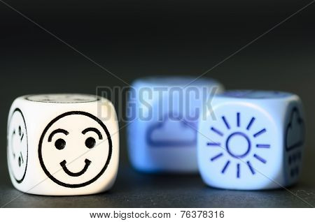 Concept Of Good  Summer Weather - Emoticon And Weather Dice On Black Background