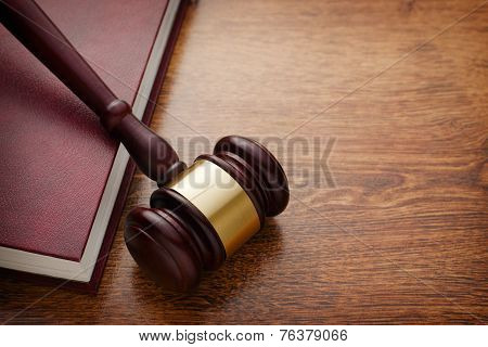 Wooden Gavel And Book On Wooden Table