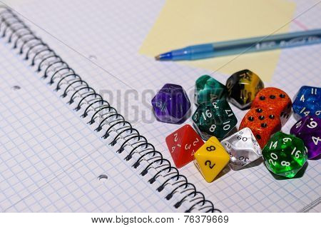 Open Exercise Book With Sticky Card, Pen And Role Playing Dices