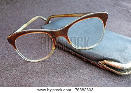 An Elderly Old Glasses With Black Leather Case