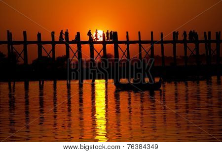 famous tick  bridge at sunset in Myanmar poster
