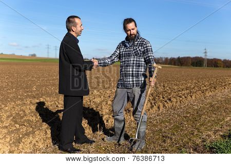Concept: Land Grabbing With A Businessman And A Farmer