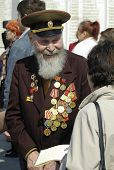 Tyumen, Russia - May 8. 2006: Wreath-laying ceremony to Eternal flame. Senior veteran of World War II on Memory square poster