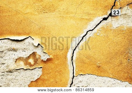 Crack in the house in ruins - wall of house destroyed during earthquake