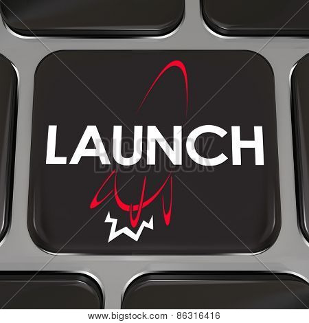 Launch word and rocket ship firing engine taking off into space on a computer keyboard key or button to illustrate starting a new company or business on the Internet