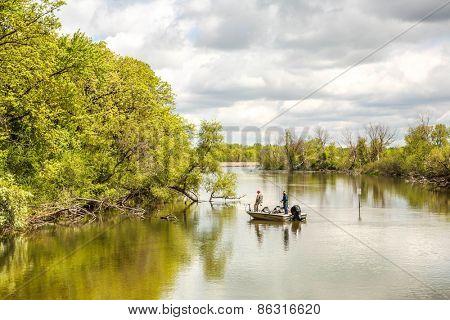 Men in boat fishing on a river