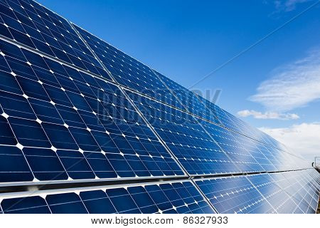 Row Of Solar Panels And Sky