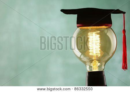 light bulb with mortar board