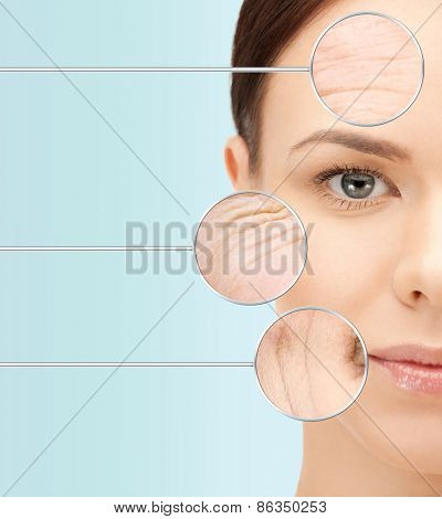 beauty, aging, people, skincare and health concept - beautiful young woman face with wrinkles over blue background
