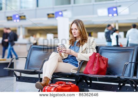 Woman At International Airport, Reading Ebook And Drinking Coffee