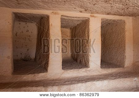 Inside a Nabatean tomb in Madaоn Saleh archeological site Saudi Arabia. poster