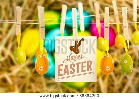 happy easter against easter eggs grouped together on straw