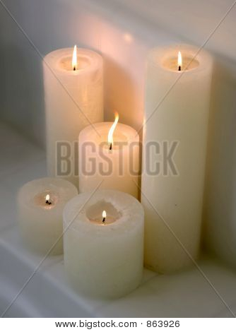 Cluster of 5 lit candles