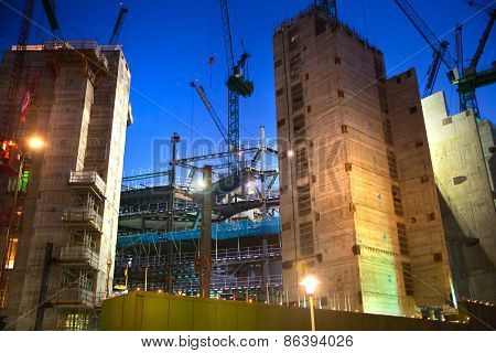 LONDON, UK - DECEMBER 19, 2014: Building site with cranes in the City of London business. New develo