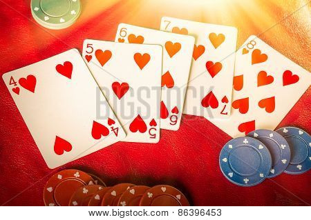 Beams of heavenly light illuminate a winning hand straight flush of hearts poster