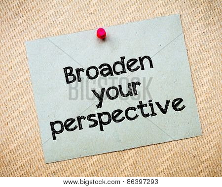 Broaden your perspective Message. Recycled paper note pinned on cork board. Concept Image poster