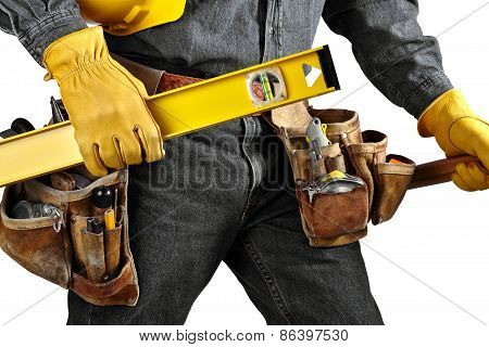 Man in black denim wearing used tool belt filled with carpenter tools carrying a yellow level hardhat and hammer poster