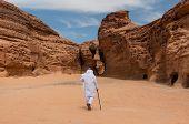 Saudian walking in Madaîn Saleh archeological site Saudi Arabia. poster