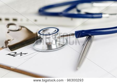 Prescription Form Lying On Table With Stethoscope And Silver Pen
