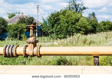 Gas Pipeline In Village In Summer Day