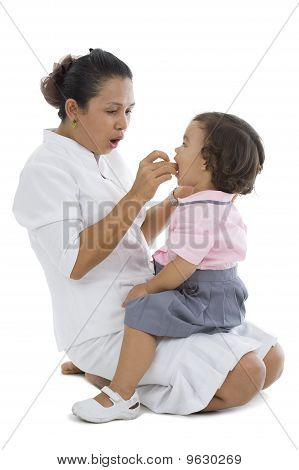 Mother Feeding Her Little Girl