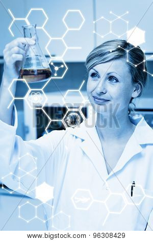 Science graphic against portrait of a bright female scientist looking at an erlenmeyer