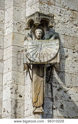 Statue Of Angel Holding Sundial At Cathedral Our Lady Of Chartres, France