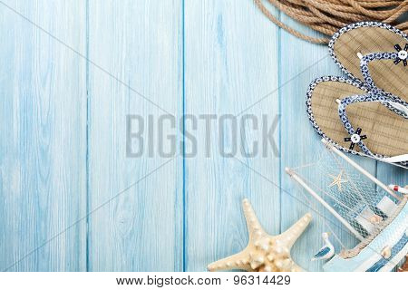 Travel and vacation items on wooden table. Top view with copy space poster