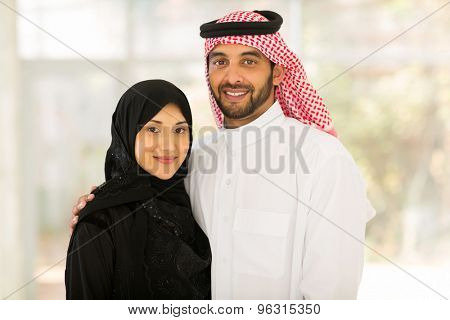 close up portrait of happy middle eastern couple at home