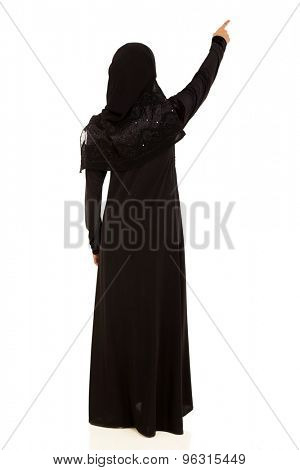 rear view of muslim woman pointing empty space