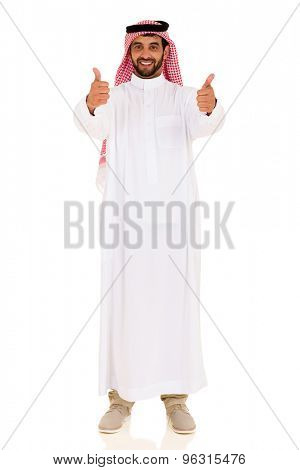 good looking arabian man giving thumbs up on white background