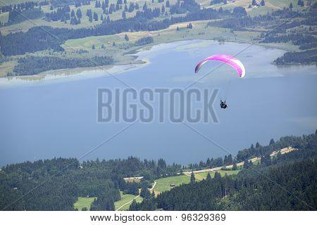 Paraglider Flying Over Bavarian Lake