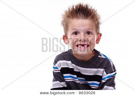 Cute Young Boy Smiling And Missing Teeth