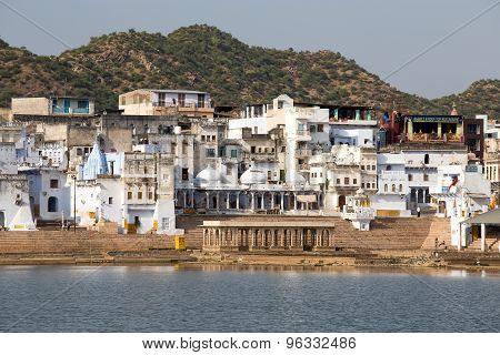 Holy ghats at sacred Sarovar lake. Pushkar - famous worship place in India
