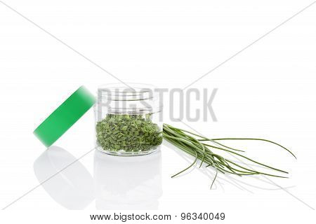 Fresh chives and dry chive spice in glass jar isolated on white background. Culinary healthy aromatic herbs. Fines herbes culinary arts. poster