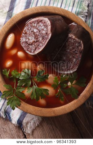 Bean Soup With Sausage Morcilla Closeup. Vertical Top View