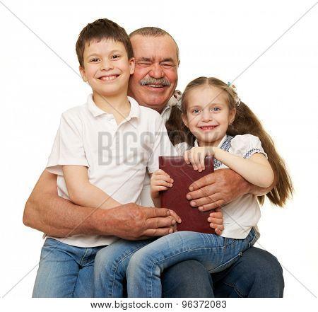 Grandfather and grandchildren read book on white