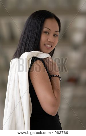 Asian Business Woman Looking Over Right Shoulder