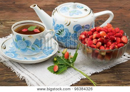 Strawberry Tea In A Pot With A National Ornament