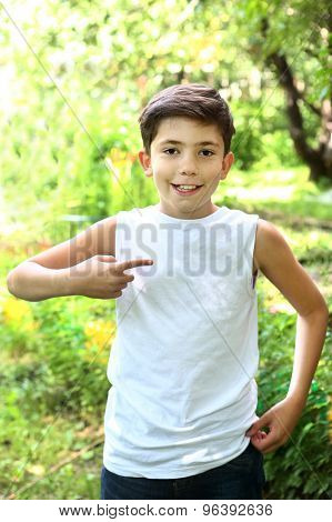 preteen handsome  boy in white tshirt free of inscription poster