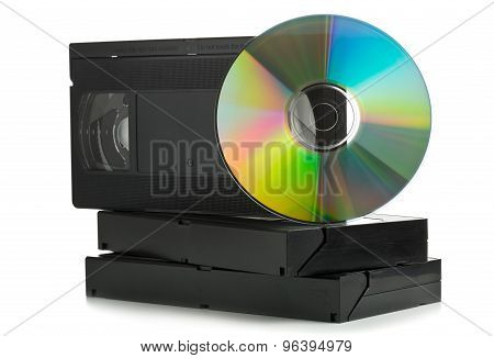 Analog video cassettes with DVD disc - old movies backup or transfer concept poster